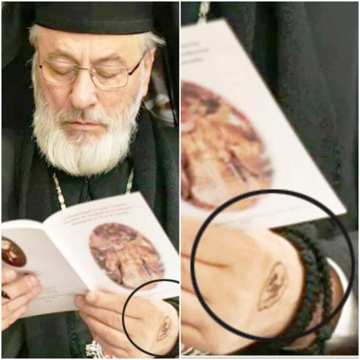 Tatuajul de pe mîna stîngă a Arhiepiscopului de Argeș și Muscel, Calinic: se presupune, o pentagramă OpusDei